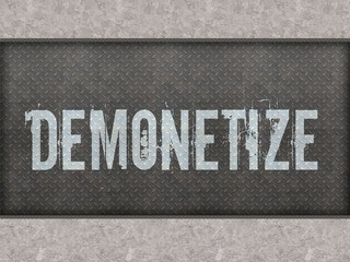 DEMONETIZE painted on metal panel wall.