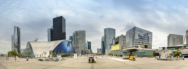 Panorama of La Defence , business and financial district with highrise skyscrapers buildings and convention center, no people and advertisments. View from Grande Arche