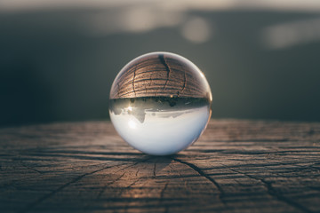 Sunrise pass through crystal ball.