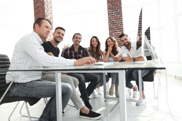 young business team sitting at Desk