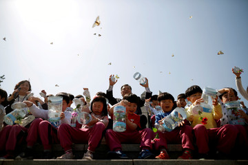 Children release butterflies during an event to wish for a successful inter-Korean summit, near the demilitarized zone separating the two Koreas in Paju