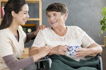 Caregiver talking to pensioner
