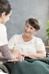 Nurse comforting senior