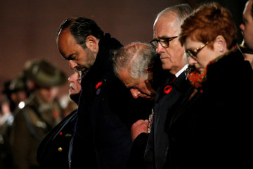 French Prime Minister Edouard Philippe, Britain's Prince Charles and Australian Prime Minister Malcolm Turnbull attend the dawn service to mark the ANZAC commemoration ceremony at the Australian National Memorial in Villers-Bretonneux