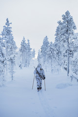 Hunters in winter forest