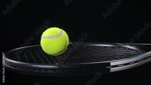 Slow Motion Of Tennis Ball Bouncing On Racket Black Background