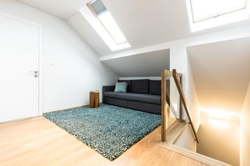 Hidden sofa in attic