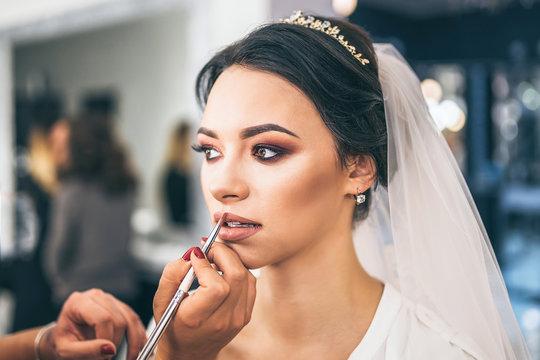 Pretty  bride on makeup before wediing
