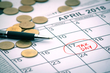 "April monthly calendar with the 17th circled with the words ""Tax Day"" written in the circle in red colour"