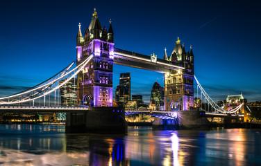 London Tower Bridge And Thames River At Night
