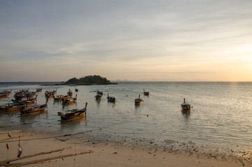 beach at low tide with taxi long tail boat,lipe island