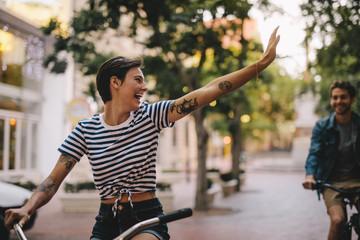 Couple enjoying cycling through city