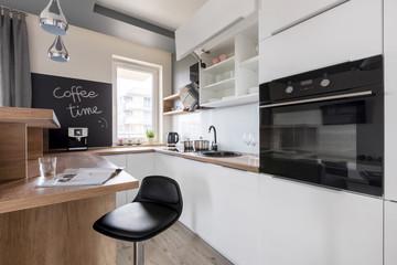 White kitchen unit and stool