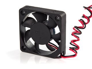 Black miniature cooling Fan with red and black wires, isolated on white, close-up view