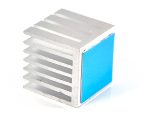 Small aluminum heat sink with blue adhesive tape, isolated on white