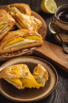 Scones with apple and mango and cup of tea.