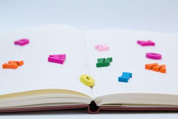 Книга и большие, цветные буквы.