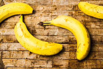 Bananas on rustic wooden background