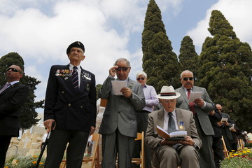 Military veterans take part in a service to mark the 100th anniversary of ANZAC landings at Gallipoli, at the Pieta Military Cemetery in Pieta, Malta