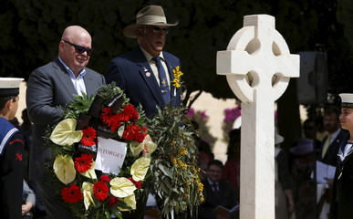 Military veterans carry wreaths during a service to mark the 100th anniversary of ANZAC landings at Gallipoli, at the Pieta Military Cemetery in Pieta, Malta