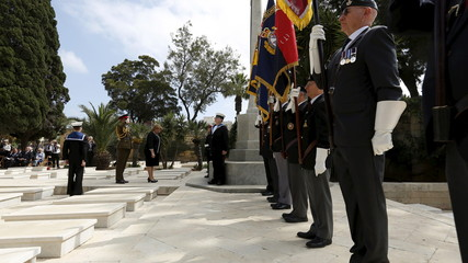 Malta's President Marie-Louise Coleiro Preca pays her respects after laying a wreath during a service to mark the 100th anniversary of ANZAC landings at Gallipoli, at the Pieta Military Cemetery in Pieta, Malta