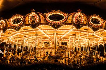 Merry-Go-Round (carousel) illuminated at night.
