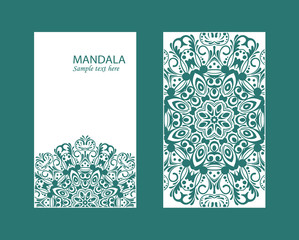 Flyer laser cut mandala. Cut paper card with lace pattern in dark teal. Wedding invitations, postcards and business card templates. Decorative cards for laser cutting.