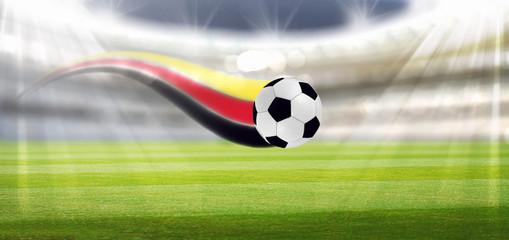 Fußball im Stadion mit Deutschland Flagge.