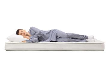Teenager sleeping on a mattress