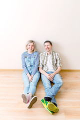 Picture of man and woman sitting on floor