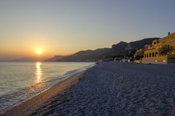 Italy, Liguria, Riviera di Ponente, Finale Ligure, sunset at beach Varigotti