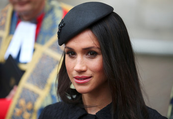 Britain's Prince Harry's fiancee Meghan Markle leaves an ANZAC day service at Westminster Abbey in London
