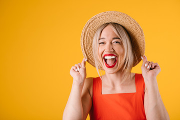 Happy laughing young blonde woman in straw hat. Warm summer mood bright colors. satisfied emotions joyful mood