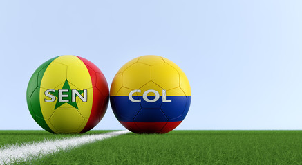 Colombia vs. Senegal Soccer Match - Soccer balls in Senegals and Colombias national colors on a soccer field. Copy space on the right side - 3D Rendering