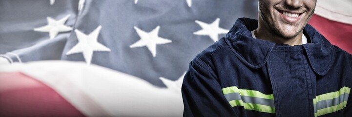 Composite image of smiling firefighter