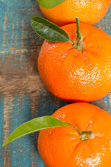 Ripe colorful tropical citrus fruits, mandarins or clementines close up