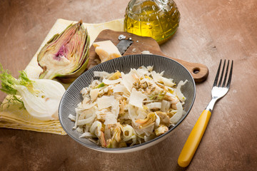 salad with artichoke, fennel, parmesan cheese flakes and fennel seeds