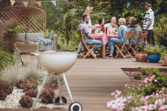 Grill on wooden garden patio