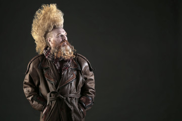 adult man with a beard and a high mohawk