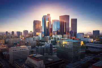 Fototapete - Sunset over Los Angeles downtown. Retro colors. California theme. LA background. Los Angeles city center.