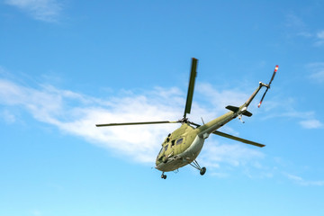 The military sends a helicopter contract up or down the ground. Helicopter landed. Poland