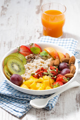 oatmeal porridge, with fresh fruit, orange juice and superfoods