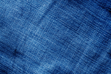Jeans texture with blur effect in navy blue color.
