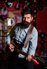 Instrumentalist concept. Musician with beard play electric guitar musical instrument.