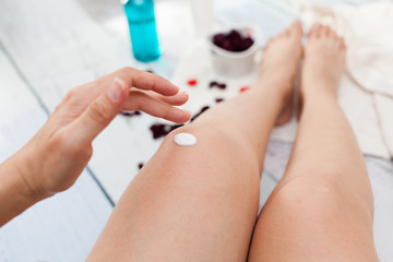 Apply cream on legs