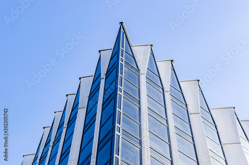 high tech modern architecture buildings. Detail Of Office Building Exterior. Business Buildings Skyline Looking Up  With Blue Sky. Modern High Tech Modern Architecture .