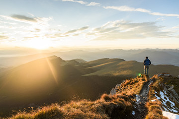 Silhouette of the man on top the peak of mountain on sunrise sky , Sport and active life conceptual...