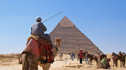 Camel rides around the Pyramid of Khafre in Giza, Egypt
