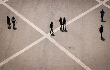 Aerial view of a group of people walking in a square in the city of lisbon in Portugal