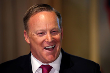 """Former White House Press Secretary Sean Spicer speaks at the unveiling of a new wax figure of U.S. first lady Melania Trump while promoting his new book """"The Briefing"""" at Madame Tussauds in New York City"""